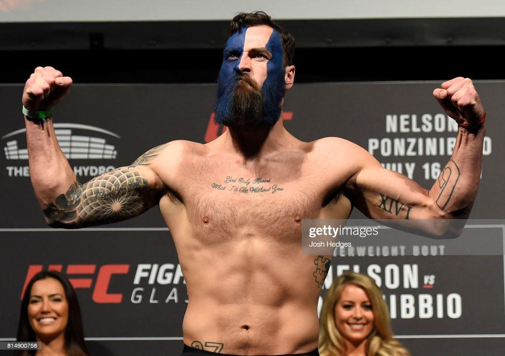 Paul Craig of Scotland poses on the scale during the UFC Fight Night weigh-in at the SSE Hydro Arena Glasgow on July 15, 2017 in Glasgow, Scotland.