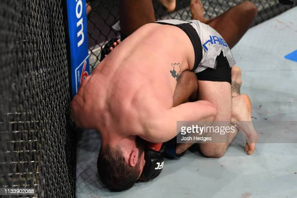 Paul Craig of Scotland submits Kennedy Nzechukwu by triangle choke in their light heavyweight bout during the UFC Fight Night event at Wells Fargo...