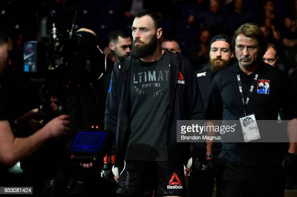 Paul Craig of Scotland walks out towards the Octagon prior to facing Magomed Ankalaev in their light heavyweight bout inside The O2 Arena on March 17...
