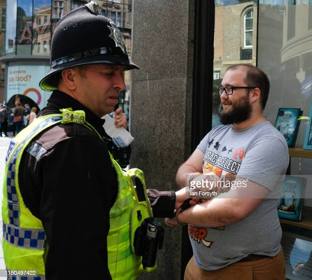 Paul Crowther is pulled away by security and held by police after throwing what was thought to be milkshake over Brexit Party leader Nigel Farage in...