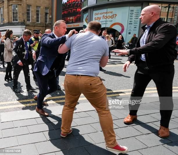 Paul Crowther is pulled away by security and held by police after throwing what was thought to be milkshake over Brexit Party leader Nigel Farage...