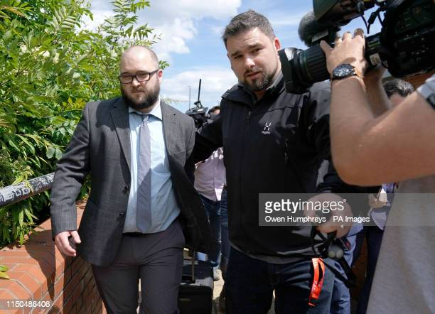 Paul Crowther who threw milkshake over Nigel Farage is ushered away as he leaves North Tyneside Magistrates' Court in North Shields where he has been...