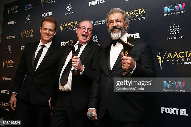 Paul Currie Bruce Davey and Mel Gibson pose in the media room after winning the AACTA Award for Best Film presented by Foxtel for Hacksaw Ridge at...