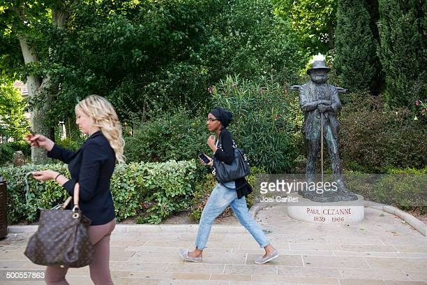 paul cézanne statue and smart phones - paul cezanne stock photos and pictures