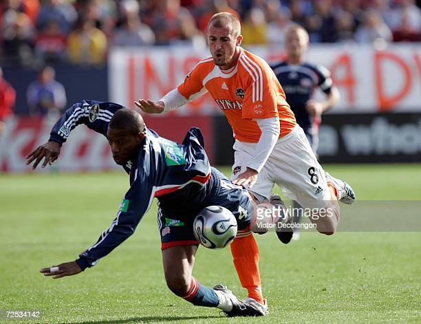 Paul Dalglish of the Houston Dynamo bowls over Avery John of the New England Revolution during the 2006 MLS Cup at Pizza Hut Park on November 12,...