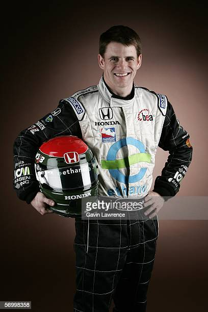 Paul Dana driver of the Rahal Letterman Menards Johns Manville Panoz Honda poses for his portrait during the media day for the IRL Indycar Series on...