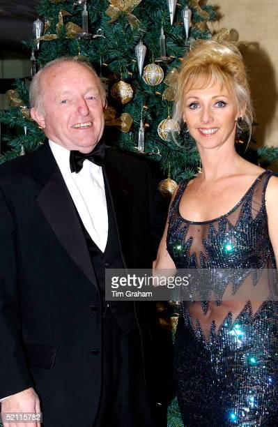 Paul Daniels Illusionist And Magician With His Wife Debbie Mcgee In Front Of The Christmas Tree At A Fundraising Event For The Sparks Charity Which...