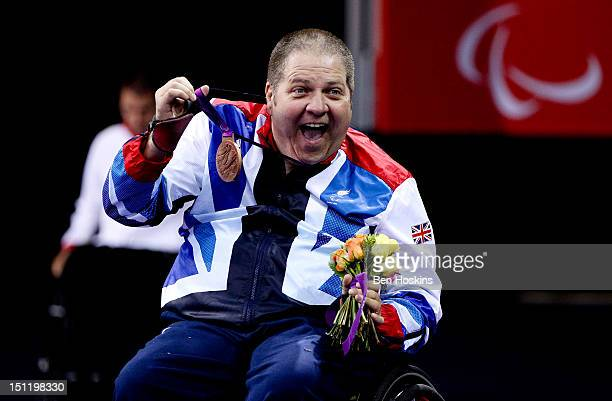 Paul Davies of Great Britain celebrates with his medal after winning bronze during the Men's Singles Table Tennis - Class 1 on day 5 of the London...