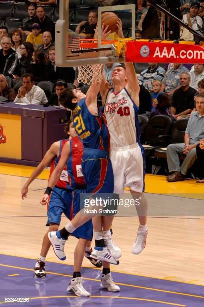 Paul Davis of the Los Angeles Clippers has his shot challenged by Ersan Ilyasova of Regal FC Barcelona at Staples Center on October 19 2008 in Los...