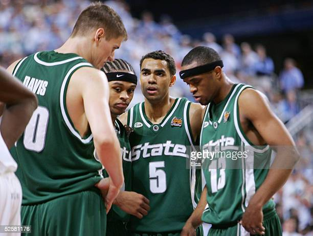 Paul Davis, Shannon Brown, Chris Hill and Maurice Ager of the Michigan State Spartans huddle near the end of the second half of the NCAA Men's Final...