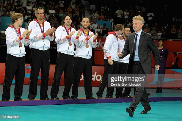 Paul Deighton CEO of LOCOG presents the bronze medals of the Men's Sitting Volleyball competition on day 10 of the London 2012 Paralympic Games at...