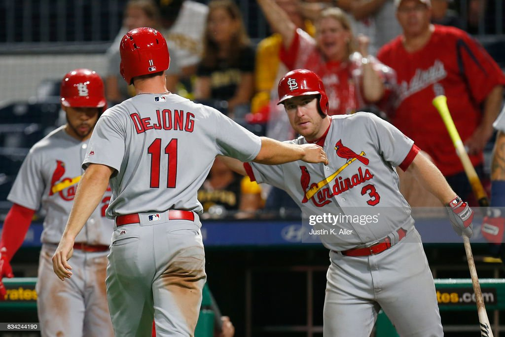 Paul DeJong #11 of the St. Louis Cardinals and Jedd Gyorko #3 of the St. Louis Cardinals celebrate after a two RBI triple in the seventh inning against the Pittsburgh Pirates at PNC Park on August 17, 2017 in Pittsburgh, Pennsylvania.