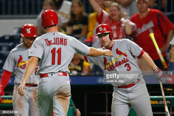 Paul DeJong of the St Louis Cardinals and Jedd Gyorko of the St Louis Cardinals celebrate after a two RBI triple in the seventh inning against the...