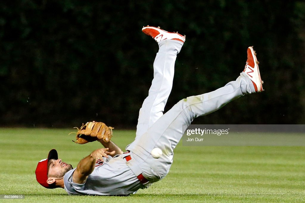 Paul DeJong #11 of the St. Louis Cardinals attempts to throw to second base after the ball was deflected by Matt Bowman #67 (not pictured) on a single by Jason Heyward #22 of the Chicago Cubs (not pictured) during the seventh inning at Wrigley Field on June 4, 2017 in Chicago, Illinois.