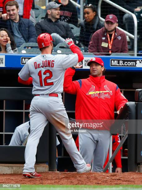 Paul DeJong of the St Louis Cardinals celebrates his eighth inning home run against the New York Mets with manager Mike Matheny at Citi Field on...