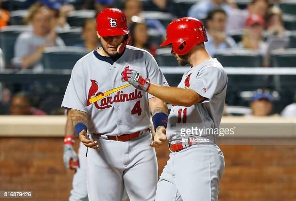 Paul DeJong of the St Louis Cardinals celebrates his sixth inning two run home run against the New York Mets with teammate Yadier Molina on July 17...