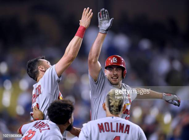 Paul DeJong of the St Louis Cardinals celebrates his two run homerun with Matt Carpenter Jose Martinez and Yadier Molina to take a 31 lead over the...