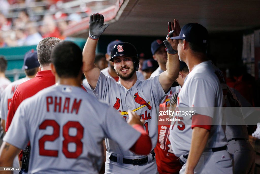 Paul DeJong #11 of the St. Louis Cardinals celebrates in the dugout after hitting a solo home run in the third inning of a game against the Cincinnati Reds at Great American Ball Park on September 20, 2017 in Cincinnati, Ohio.