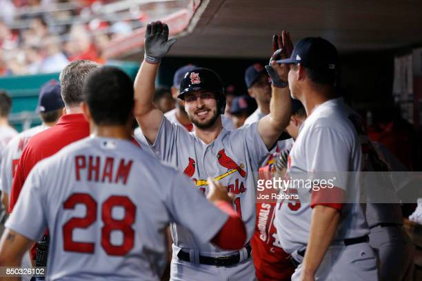 Paul DeJong of the St Louis Cardinals celebrates in the dugout after hitting a solo home run in the third inning of a game against the Cincinnati...