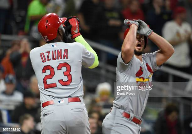 Paul DeJong of the St Louis Cardinals celebrates with Marcell Ozuna after hitting a threerun home run during the second inning of a baseball game...