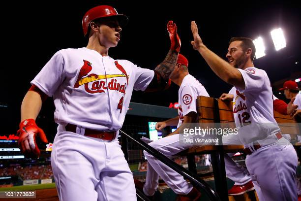 Paul DeJong of the St Louis Cardinals congratulates Tyler O'Neill of the St Louis Cardinals after O'Neill's threerun home run against the Pittsburgh...