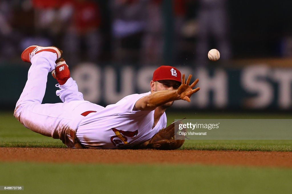Paul DeJong #11 of the St. Louis Cardinals flips the ball to second base against the Cincinnati Reds in the fifth inning at Busch Stadium on September 13, 2017 in St. Louis, Missouri.