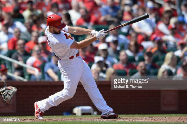 Paul DeJong of the St Louis Cardinals hits a double in the seventh inning against the New York Mets at Busch Stadium on April 26 2018 in St Louis...