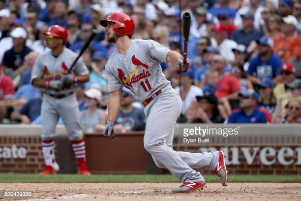 Paul DeJong of the St Louis Cardinals hits a ground rule double in the eighth inning against the Chicago Cubs at Wrigley Field on July 21 2017 in...