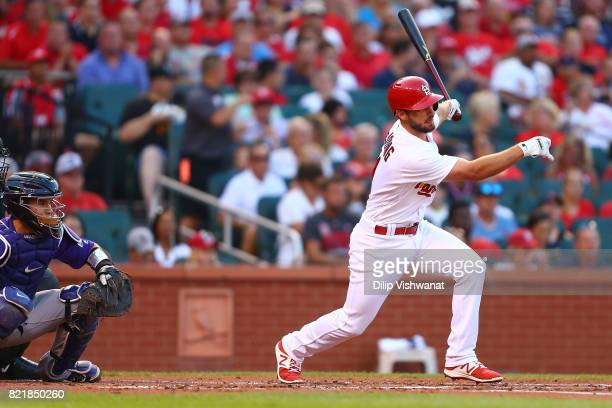 Paul DeJong of the St Louis Cardinals hits an RBI single against the Colorado Rockies in the first inning at Busch Stadium on July 24 2017 in St...
