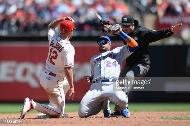 Paul DeJong of the St Louis Cardinals is called safe as Robinson Cano of the New York Mets attempts to tag him out in the third inning at Busch...