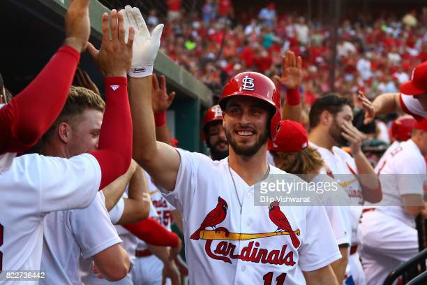 Paul DeJong of the St Louis Cardinals is congratulated after hitting a tworun home run against the Colorado Rockies in the first inning at Busch...