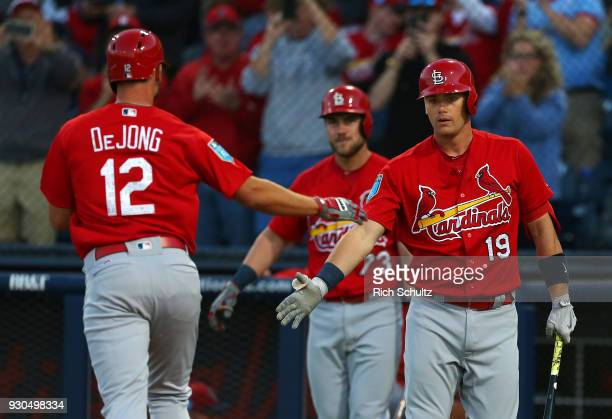 Paul DeJong of the St Louis Cardinals is congratulated by Carson Kelly and Patrick Wisdom after hitting a home run against the Houston Astros during...