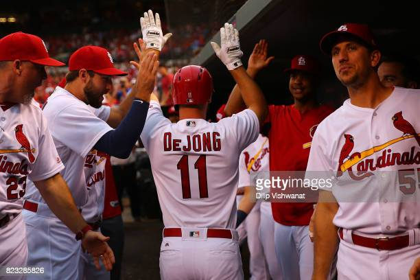 Paul DeJong of the St Louis Cardinals is congratulated by his teammates after hitting a tworun home run against the Colorado Rockies in the first...