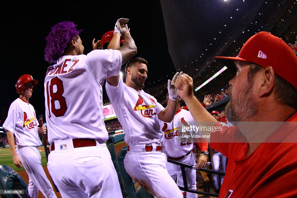 Paul DeJong #11 of the St. Louis Cardinals is congratulated by teammates after hitting a home run against the Cincinnati Reds in the sixth inning at Busch Stadium on September 12, 2017 in St. Louis, Missouri.