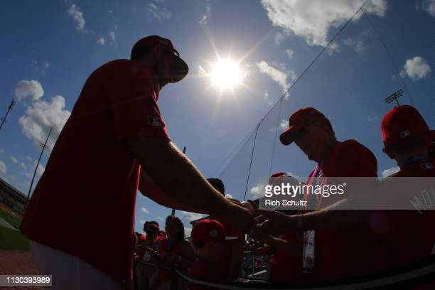 Paul DeJong of the St Louis Cardinals is silhouetted as he signs autographs before a spring training baseball game against the New York Mets at Roger...