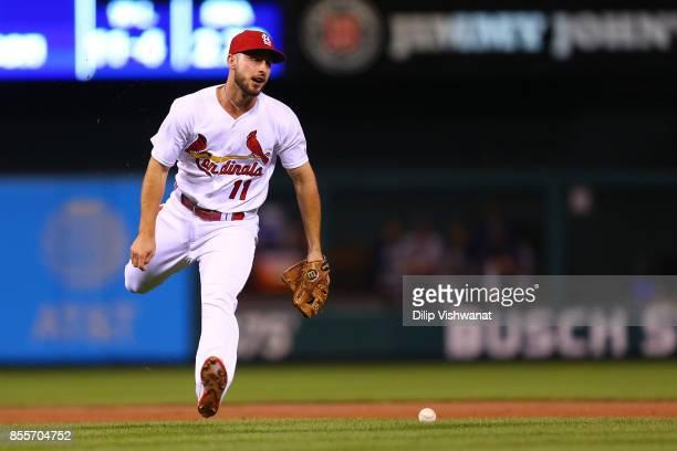 Paul DeJong of the St Louis Cardinals misplays a ground ball against the Milwaukee Brewers in the second inning at Busch Stadium on September 29 2017...
