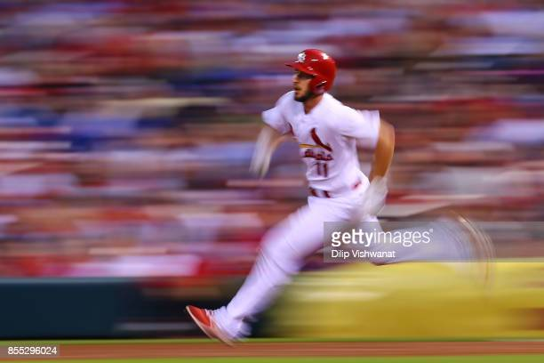 Paul DeJong of the St Louis Cardinals rounds first base on his way to a double against the Chicago Cubs in the second inning at Busch Stadium on...