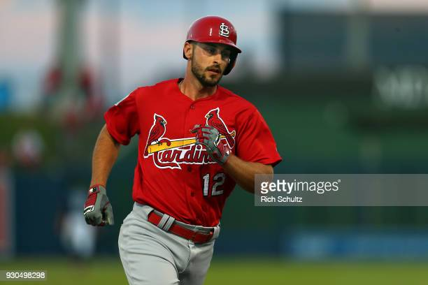 Paul DeJong of the St Louis Cardinals rounds second base after hitting a home run against the Houston Astros during the second inning of a spring...