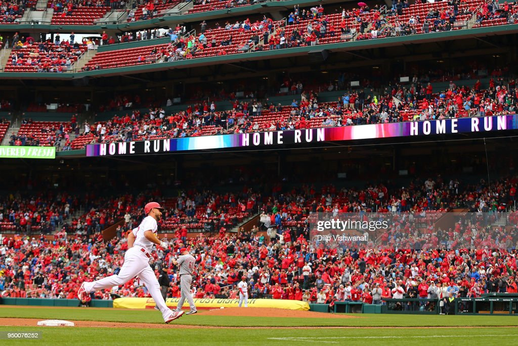 Paul DeJong #12 of the St. Louis Cardinals rounds third base after hitting a three-run home run against the Cincinnati Reds in the seventh inning at Busch Stadium on April 22, 2018 in St. Louis, Missouri.