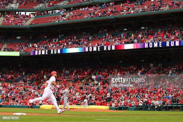 Paul DeJong of the St Louis Cardinals rounds third base after hitting a threerun home run against the Cincinnati Reds in the seventh inning at Busch...