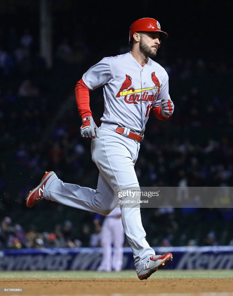 Paul DeJong #12 of the St. Louis Cardinals runs the bases after httring a solo home run in the 8th inning against the Chicago Cubs at Wrigley Field on April 17, 2018 in Chicago, Illinois.