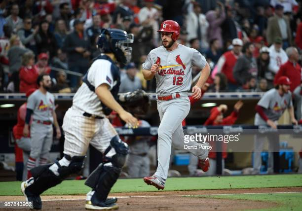 Paul DeJong of the St Louis Cardinals scores ahead of the throw to Raffy Lopez of the San Diego Padres during the sixth inning of a baseball game at...