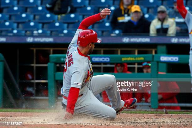 Paul DeJong of the St. Louis Cardinals scores on a passed ball in the in the eleventh inning against the Pittsburgh Pirates at the home opener at PNC...