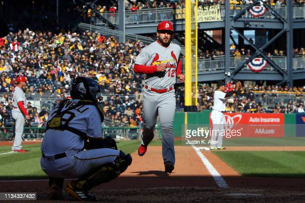 Paul DeJong of the St. Louis Cardinals scores on an RBI double in the ninth inning against the Pittsburgh Pirates at the home opener at PNC Park on...