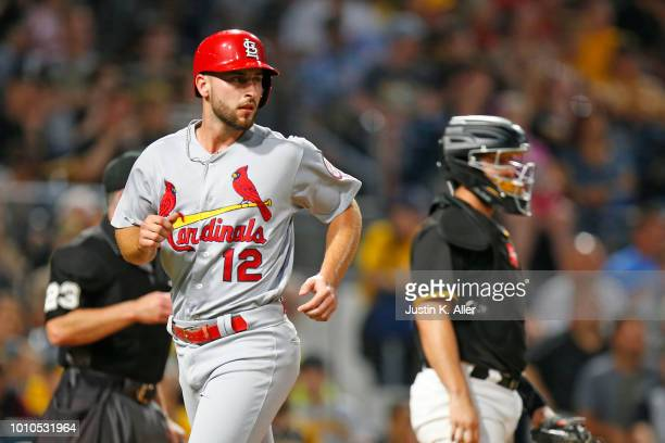 Paul DeJong of the St Louis Cardinals scores on an RBI single in the fifth inning against the Pittsburgh Pirates at PNC Park on August 3 2018 in...