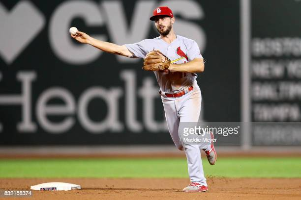 Paul DeJong of the St Louis Cardinals throws to first to force out Brock Holt of the Boston Red Sox during the eighth inning at Fenway Park on August...