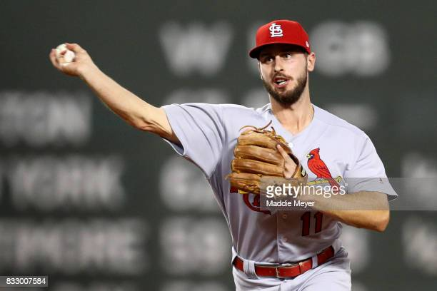 Paul DeJong of the St Louis Cardinals turns a double play over Mitch Moreland of the Boston Red Sox during the sixth inning at Fenway Park on August...