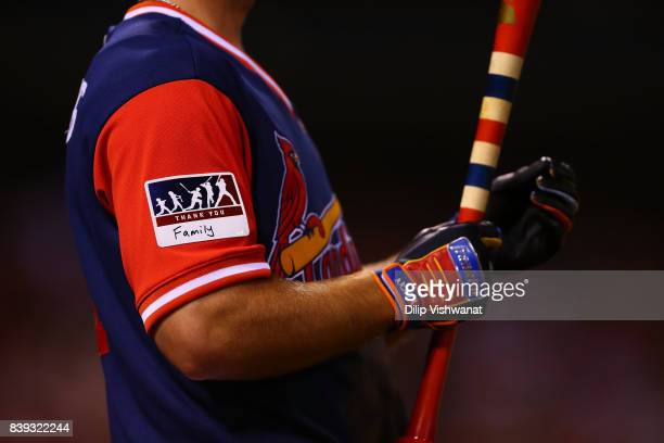 Paul DeJong of the St Louis Cardinals uses special gloves and bat and wears a thankyou patch for the Player's Weekend against the Tampa Bay Rays at...