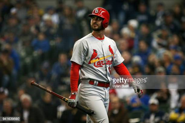 Paul DeJong of the St Louis Cardinals walks back to the dugout after striking out in the fifth inning against the Milwaukee Brewers at Miller Park on...