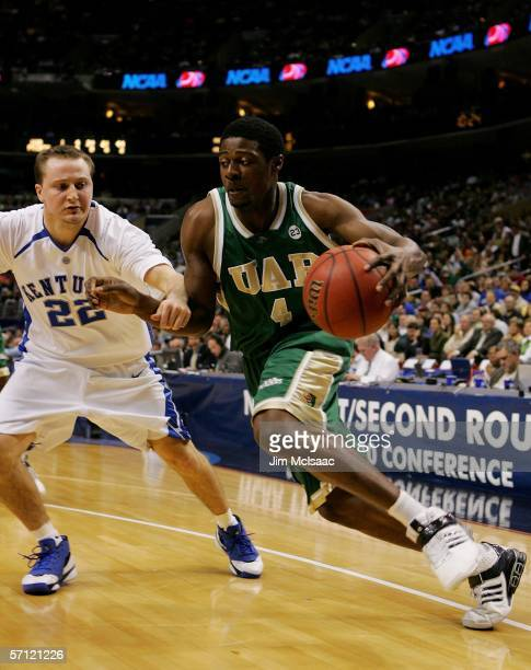 Paul Delaney III of the UAB Blazers drives to the hoop around Patrick Sparks of the Kentucky Wildcats during the First Round of the 2006 NCAA Men's...